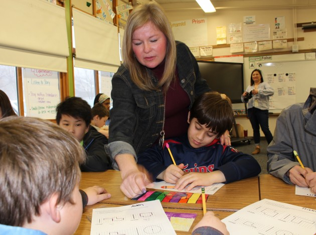 Kenny Community School teacher Janee Rivard-Johnson says differentiating instruction helps keep students engaged in learning. Photo by Nate Gotlieb