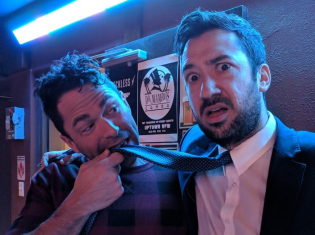 Aaron Hartung (right) allows Karl Turba to eat his tie on Feb. 27 as he hosts his final night of trivia at the James Ballentine VFW in Uptown. Submitted photo