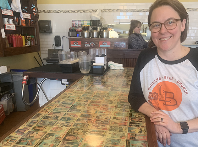"Jodi Ayres and her baseball card collection at the Lowbrow bar in Kingfield. ""It's definitely very lo-fi. Anytime people comment on it, I get really excited,"" she said. Photo by Jim Walsh"