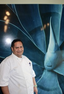 Chef and Restaurateur Hector Ruiz poses in his newest effort, Don Raúl/DR49, which is now open in Fulton. Photo by Andrew Hazzard.