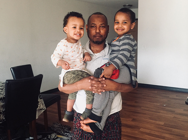 Mohamud Mohamed poses for a photo with his sons Abdiqani (right) and Abdirizak. The brothers fell four stories from an apartment building rooftop on May 2.
