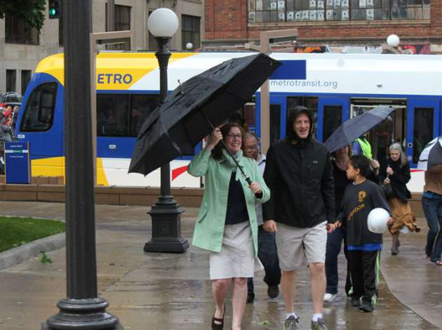 Riders arrive at St. Paul's Union Depot Station after a trip on the new Green Line on opening day Saturday, June 14.  Credit: Photo by Sarah McKenzie