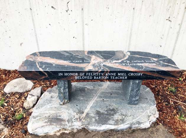 A bench dedicated to Felicity Crosby in a Barton Open School garden planted in her honor. (Submitted photo by B Johnson Photos.) Credit: Submitted image