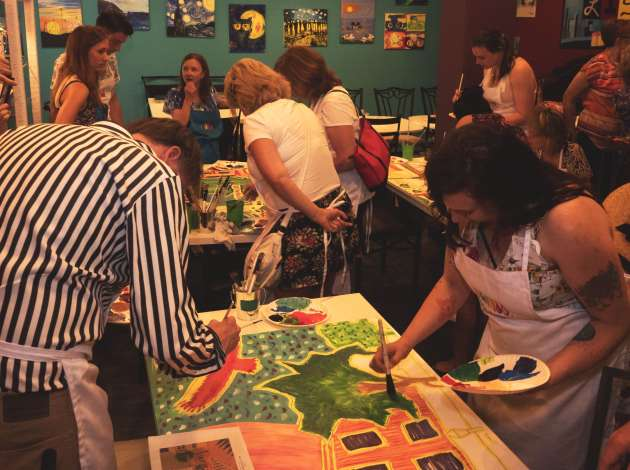 Credit: Community members painted a mural during an Uptown Art Fair launch party. Photo by Alvan Washington
