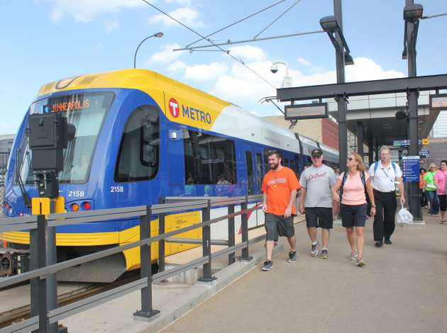 A train arrives at Target Field Station. Once complete, the Southwest LRT line will link downtown to Eden Prairie.  Credit: Photo by Sarah McKenzie