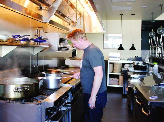 Chef Landon Schoenfeld in the kitchen at Nighthawks. Credit: File photo