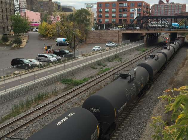 A unit train travels through downtown Oct. 3.  Credit: Photo by Sarah McKenzie