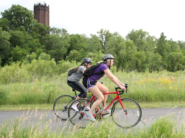 Bicyclists on the Cedar Lake Trail, part of a 651-mile network of bikeways and off-street trails in Hennepin County. Credit: File photo