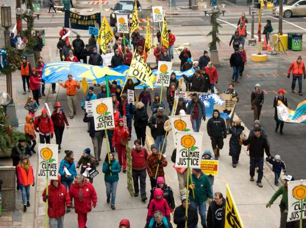 A large group demonstrated Saturday in downtown Minneapolis to call for climate justice — the same day the worldwide climate deal was reached in Paris.  Credit: Photo by Chris Paul via MN350.