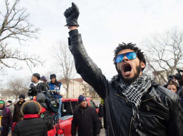 Jacob Ladda leads the marchers in chants during the Justice 4 Jamar march on Saturday.  Credit: Photos by Annabelle Marcovicci