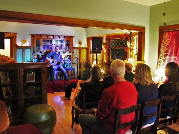 Credit: Songwriter Ryan Lee performs at a house concert in Kingfield. Photo by Michelle Bruch