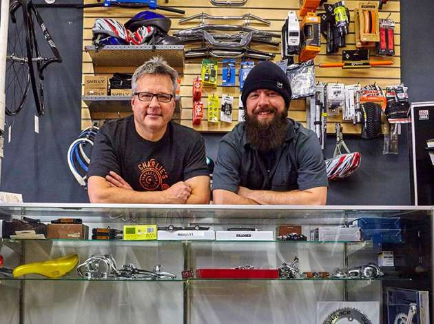 Charlie Siftar (left) and Mike O'Leary of Charlie's Tangletown Bike Shop  Credit: Photo by Phil Bode
