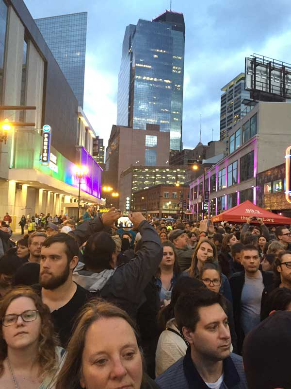 Thousands filled the streets next to First Avenue on Thursday night to celebrate the life of Prince. Photo by Sarah McKenzie