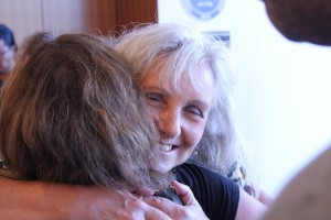 Sommers embraced a supporter after speaking out at the July 12 Board of Education meeting.