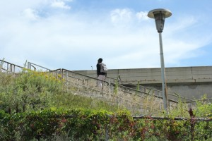 A man walked up the staircase leading from Lake Street to an express bus stop on I-35W.