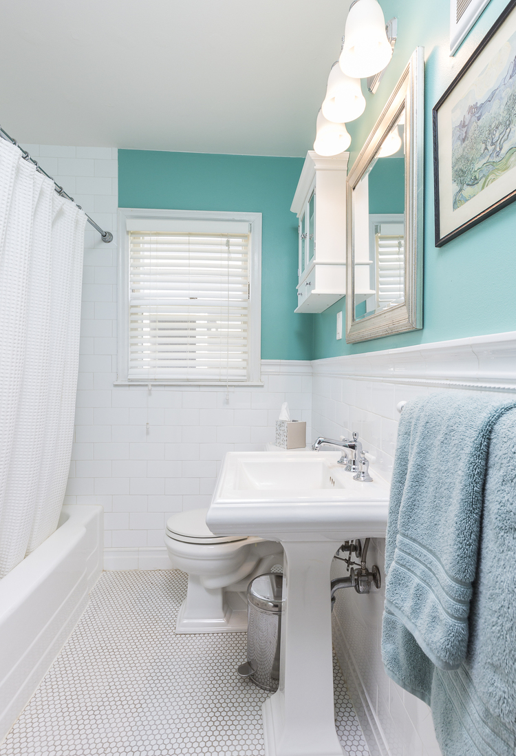"""Cleaning is key to the appeal of this bathroom. """"White tile should be white,"""" Strong said. The sellers also painted the ceiling a brighter white to reflect more light. The property received multiple offers within 12 hours. Photo by David J. Turner."""