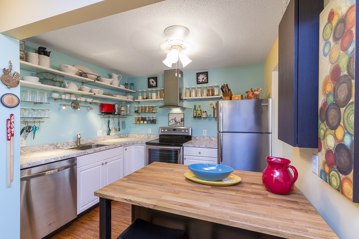 """The sellers cleaned, decluttered and made sure all the light bulbs matched in this kitchen. There was a full price offer in less than a week, """"which for condos is great"""" Strong said. Photo by David J. Turner."""
