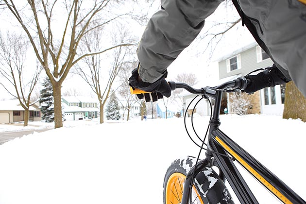 Person biking in winter