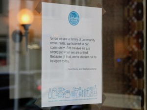 A sign notifying customers of Mercury Dining Room and Rail, part of the Blue Plate restaurants group, closed for the Day Without Immigrants. Photo by Nate Gotlieb