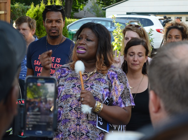 Nekima Levy-Pounds speaks at a vigil for a woman who died in an officer-involved shooting.