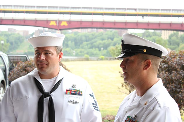 Navy Diver 1st Class Brian Bennett, left, and Chief Navy Diver Noah Gottesman returned to Minneapolis for Navy Week in July, a decade after they aided recovery efforts following the bridge collapse. Photo by Dylan Thomas