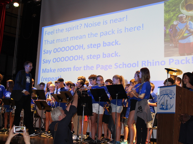 The Justice Page band leads the assembly in the new school song.