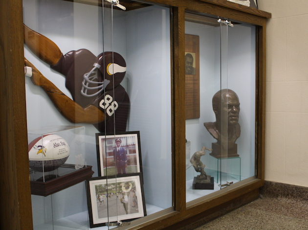 A trophy case of Alan Page memorabilia sits near the Nicollet Avenue entrance to Justice Page Middle School.