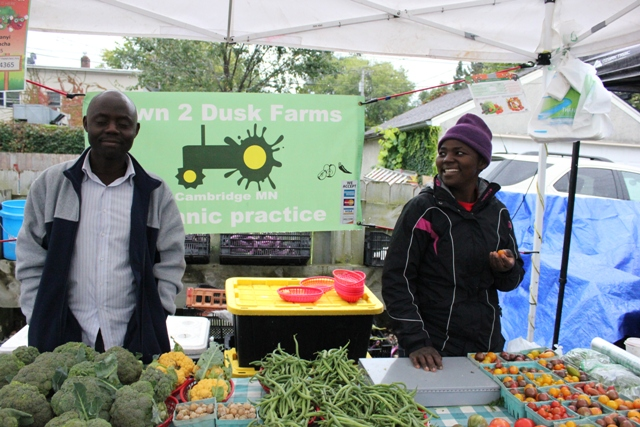 "Wilfred Nyasaka Osusu and Lonah Onyancha sell organic produce from the five-acre Cambridge, Minnesota farm ""Dawn 2 Dusk."" Onyancha said she left the city to take up farming."