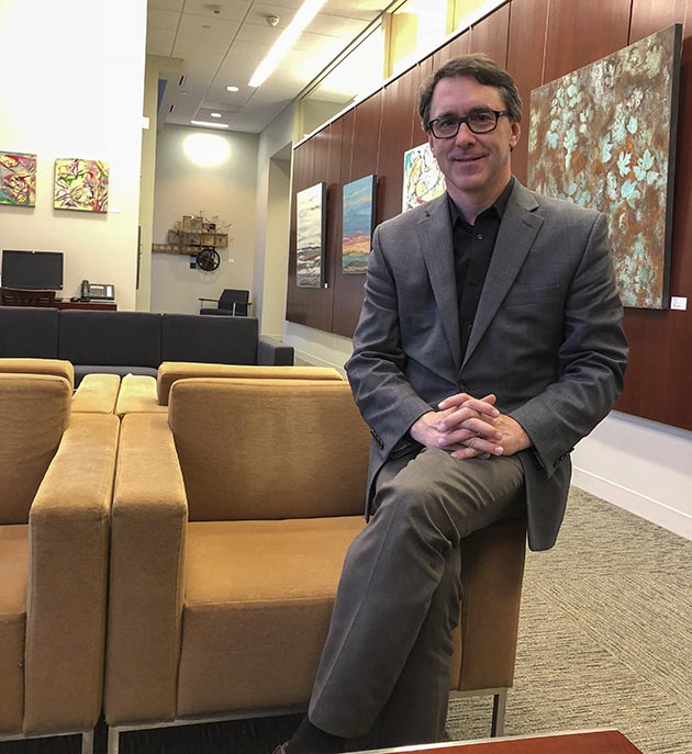 Hallberg in the Mill City Clinic's waiting room, which doubles as a gallery. Photo by Susan Schaefer