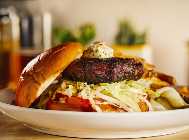 The shallot tarragon butter burger features meat ground in-house with fresh thyme and garlic. Photo by Isabel Subtil