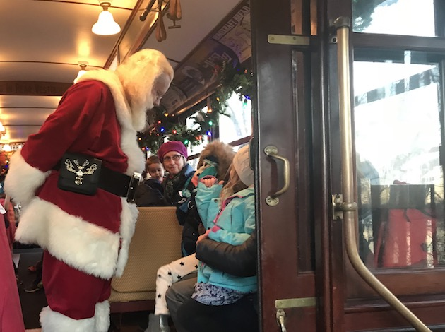A Minnesota Streetcar Museum volunteer dressed as Santa greets riders during a trolleyride on Dec. 2.