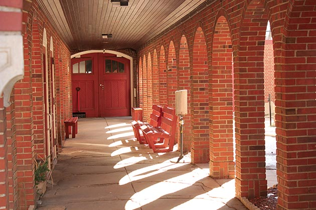 The covered walkway between the church and the rectory. Photo by Dylan Thomas