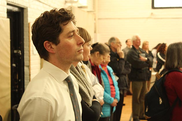 Mayor Jacob Frey listened to the activists from the side of the room. At the outset of the meeting, he dispelled rumors that he was considering adding 100 officers to the city's police force. Photo by Dylan Thomas