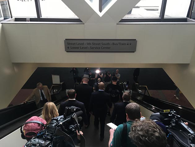 Noor and his attorneys navigated a media scrum as they left the Hennepin County Government Center after a brief hearing Tuesday morning. Photo by Dylan Thomas