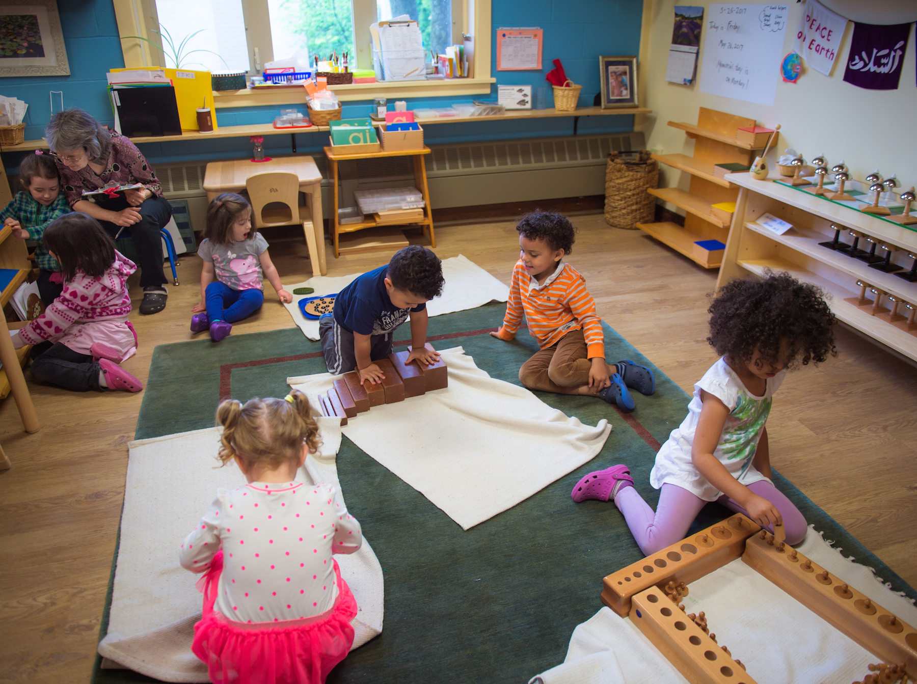 Students at Marigold Montessori School in Haverhill, Massachusetts, work in uninterrupted work blocks guided by their teachers. Photo courtesy the Wildflower Foundation