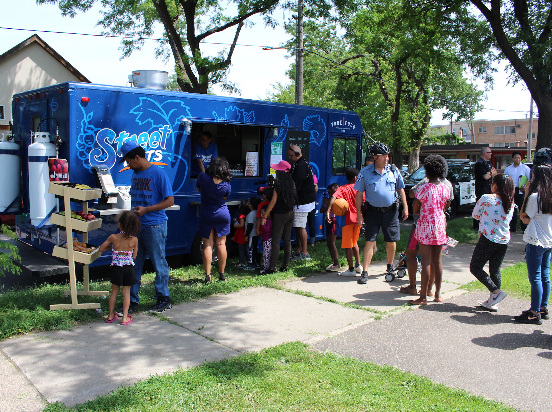 Dozens of kids lined up Thursday for fresh-cooked hamburgers.
