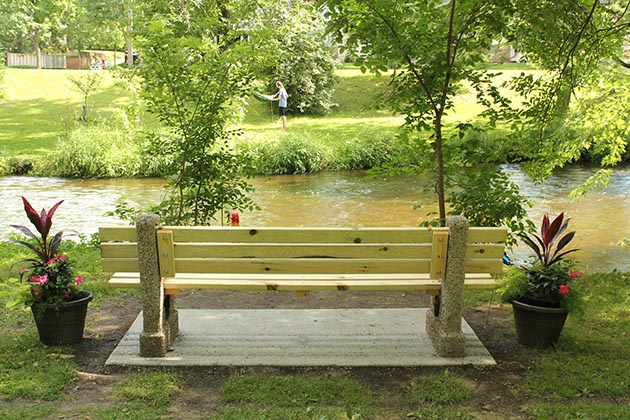 A bench near Minnehaha Creek was dedicated to Damond's memory. Photo by Dylan Thomas