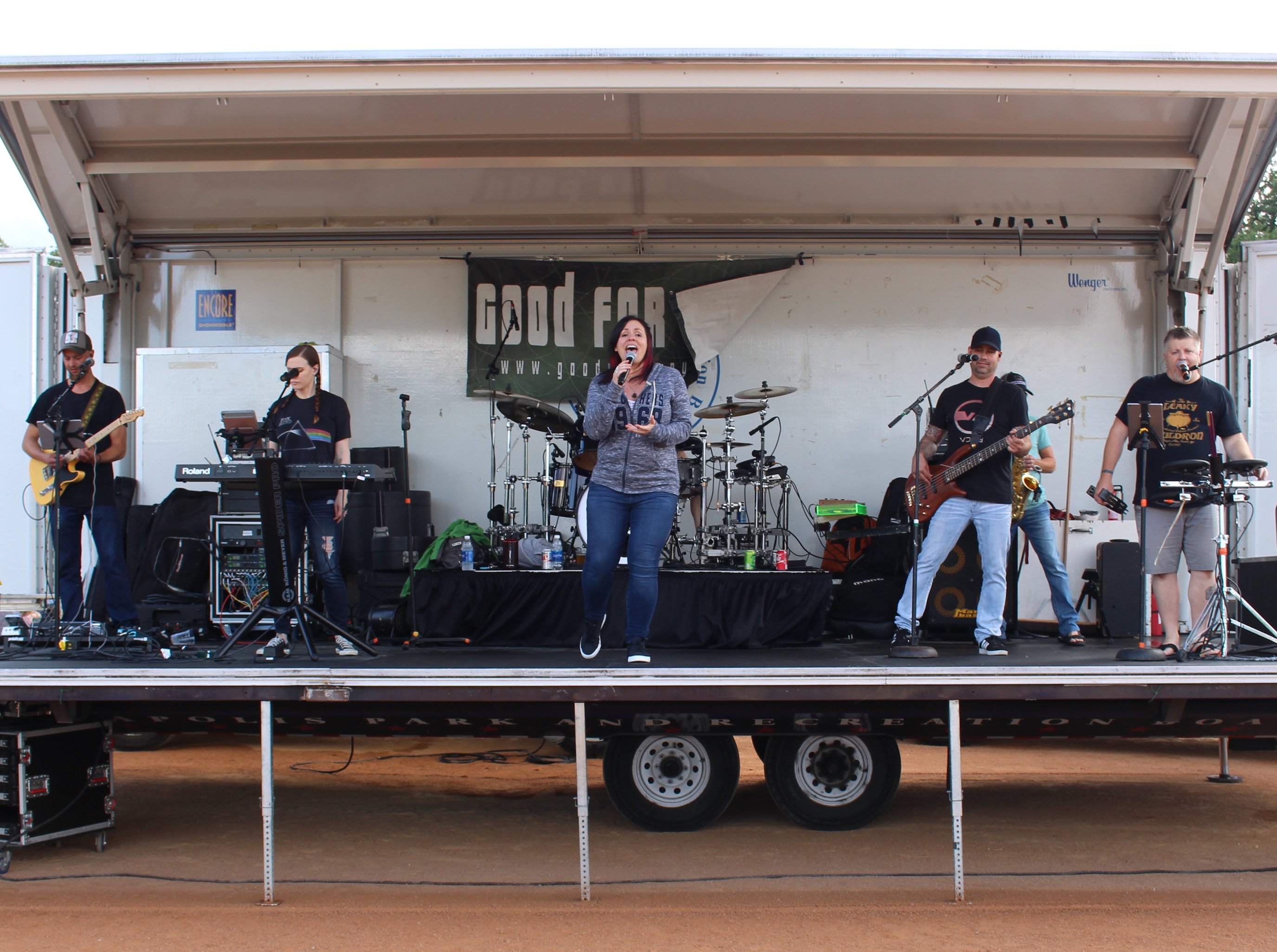 Melissa Ellingson of the band Good for Gary sings, surrounded by bandmates (from left to right) Jesse Totushek, Kiersty Santos, Benn Jackson and Dan Zschokke. Not pictured are members Kirk Stallings (drums) and Jason Minke (saxophone).
