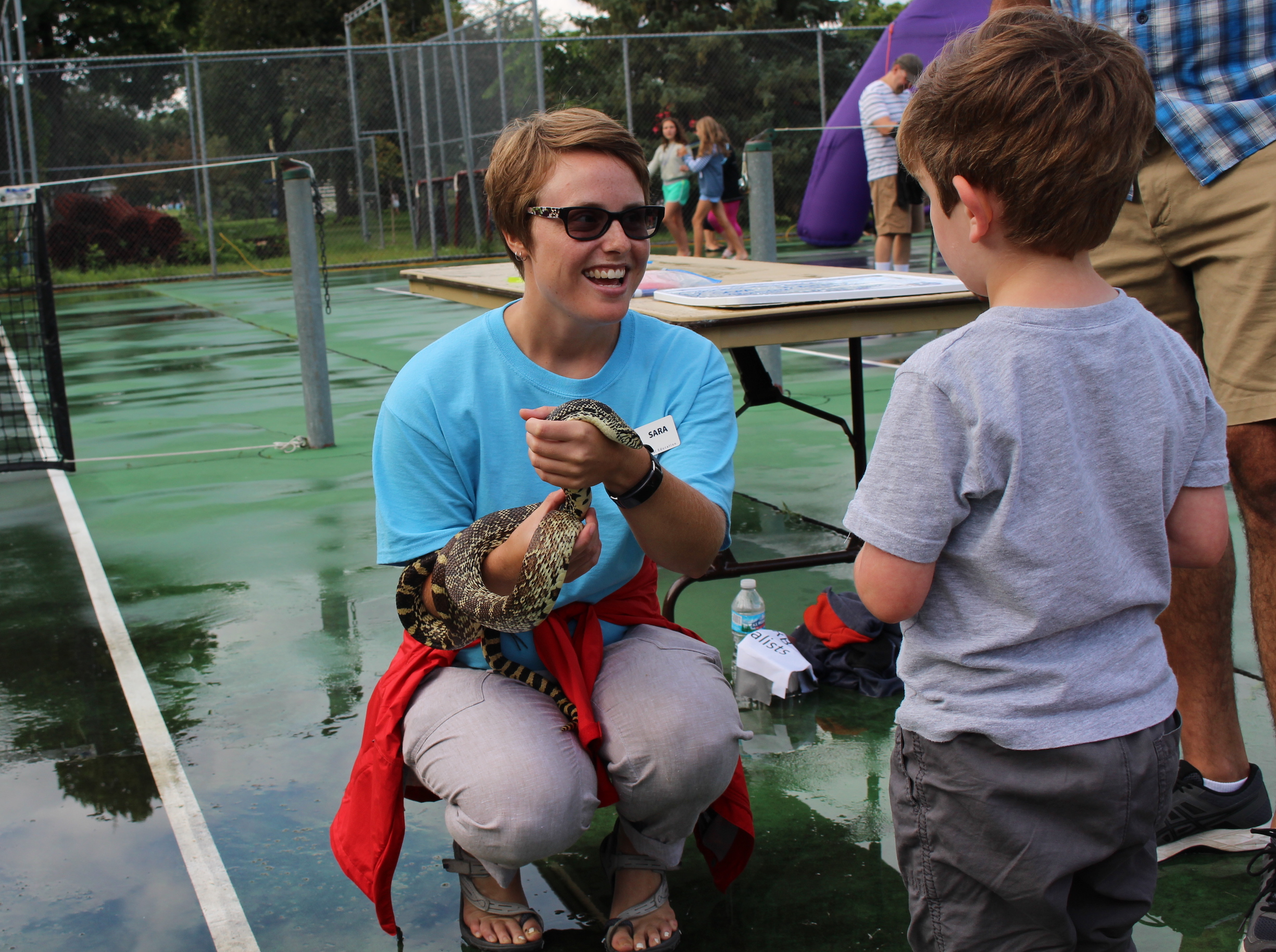 Sara Swenson with the Minneapolis Park and Recreation Board's Neighborhood Naturalist program brought a snake that kids could pet.