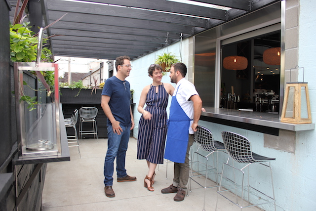 Tim Niver, Laurel Elm and Adam Eaton (l to r) at Meyvn's patio, where a window opens to the bar inside.