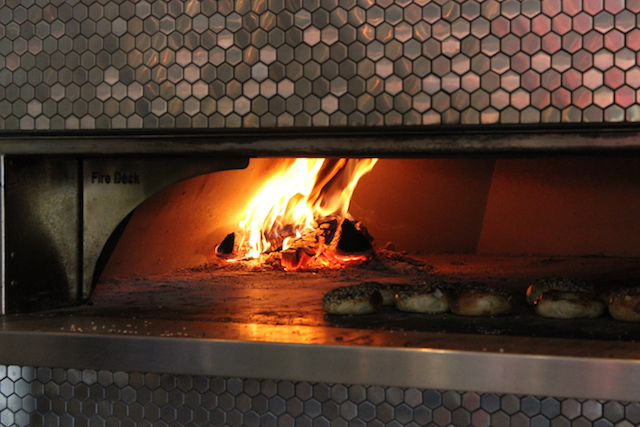 The wood-fired oven at Meyvn was used to bake their signature bagels and cook meats. Photo by Michelle Bruch.