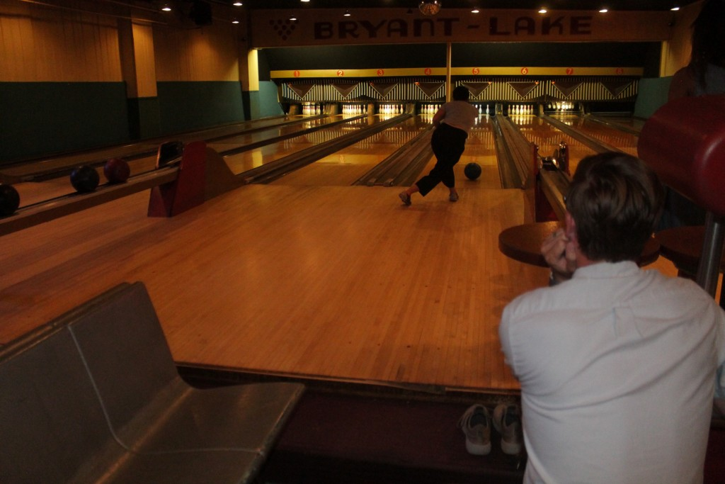 Matthew Fenske, 29, watching Kristi Moua, 27, bowl. Photo by Austen Macalus