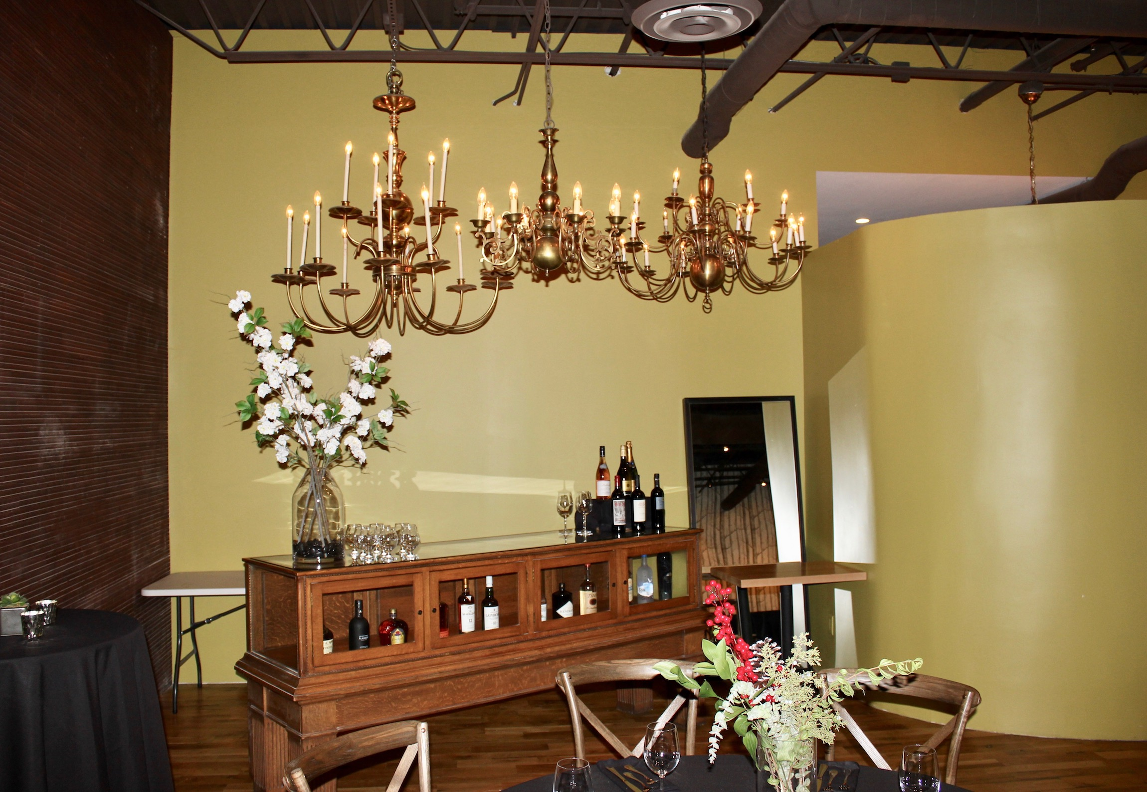 Nord Social Hall, the new events space at French Meadow Bakery on Lyndale Ave. features repurposed antiques like these 19th century chandeliers and an old jewelry display case repurposed as a bar. Photo by Andrew Hazzard