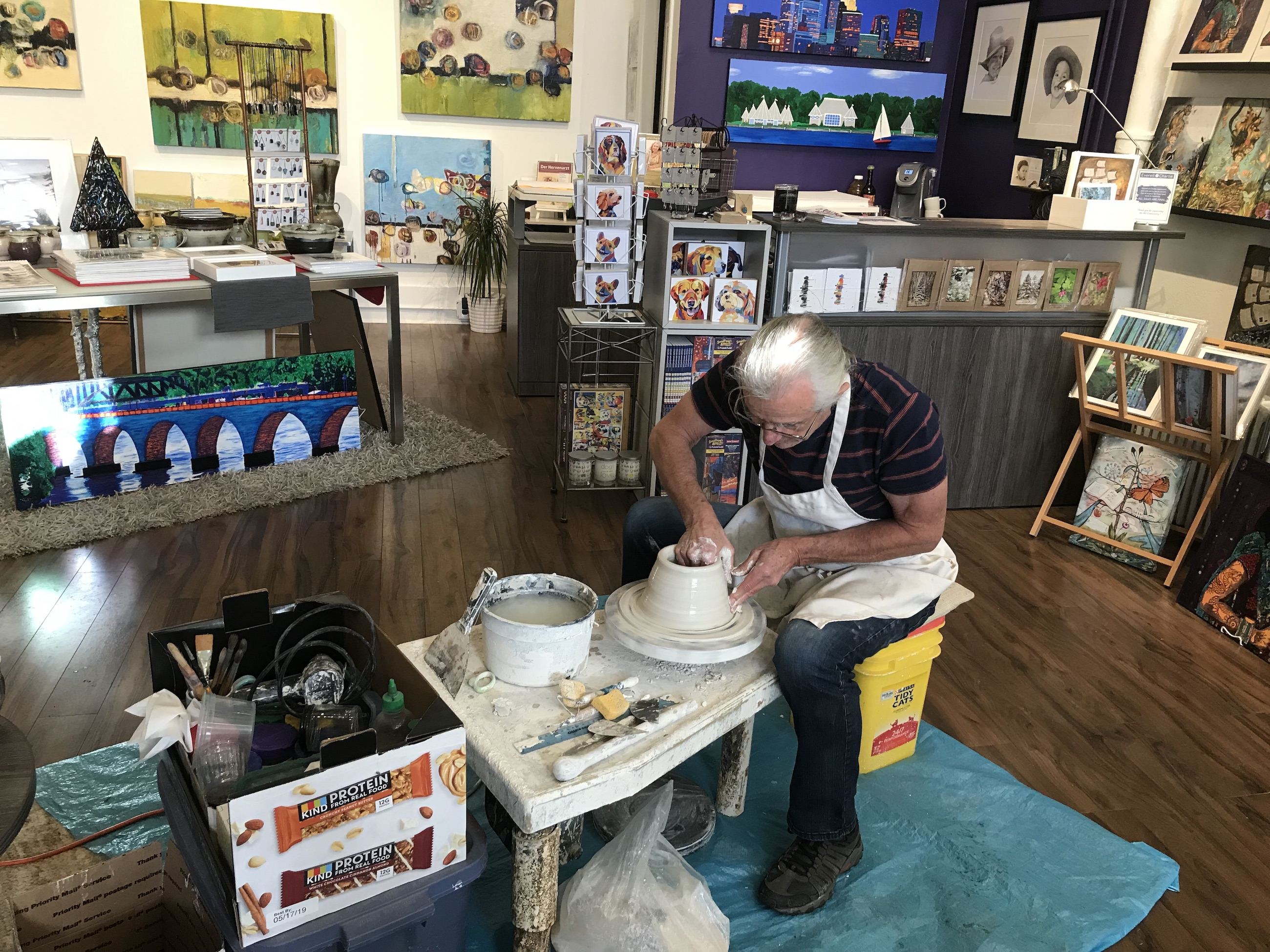 Bill Kaufmann of Linden Hills Pottery mans the wheel at an art show at the Everett & Charlie Gallery at 2720 W. 43rd St. Submitted image.