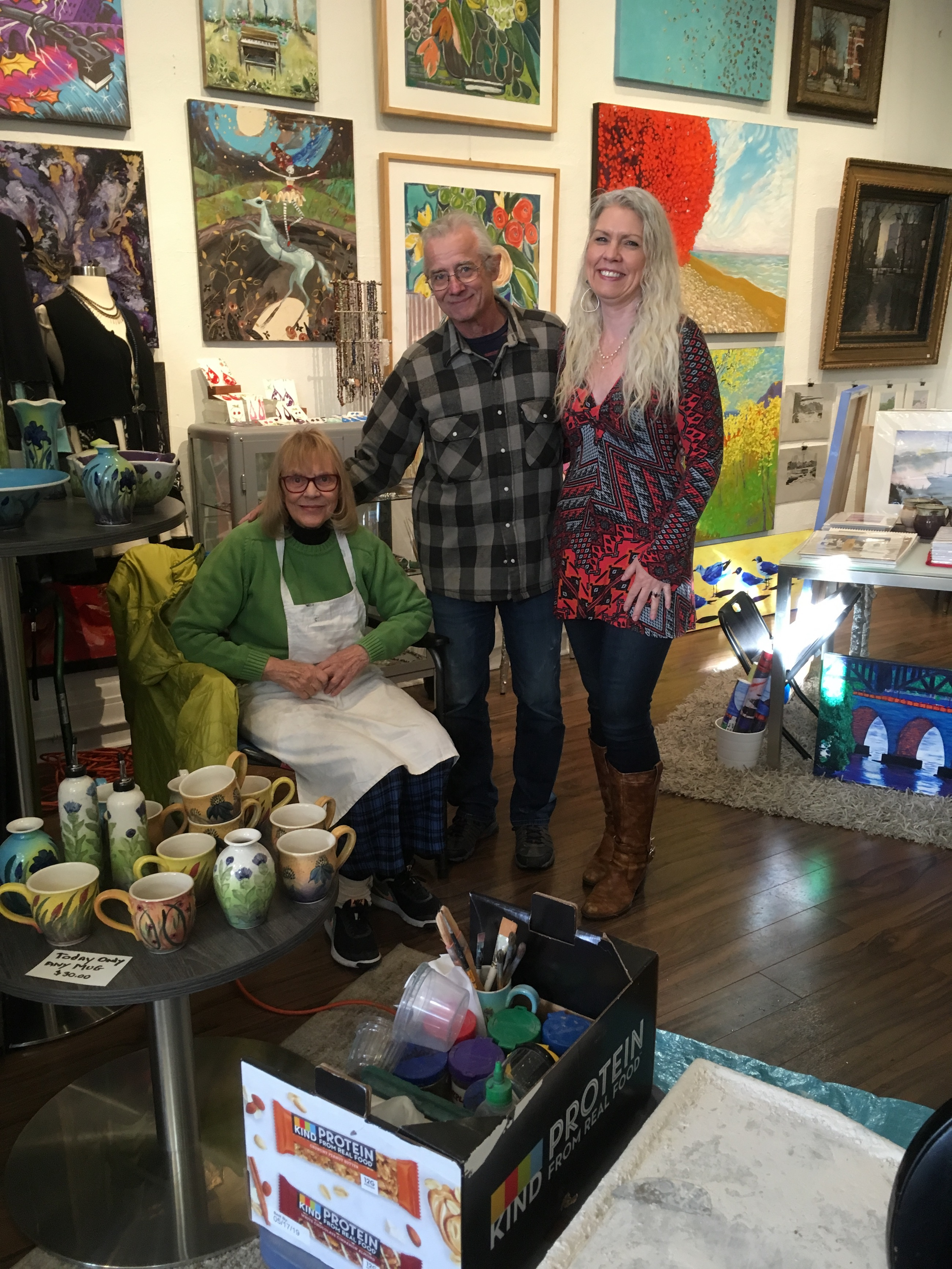 Cynthia Mosedale, left, and her husband Bill Kaufmann of Linden Hills Pottery, stand with curator Suzie Marty at Everett & Charlie. Submitted image.