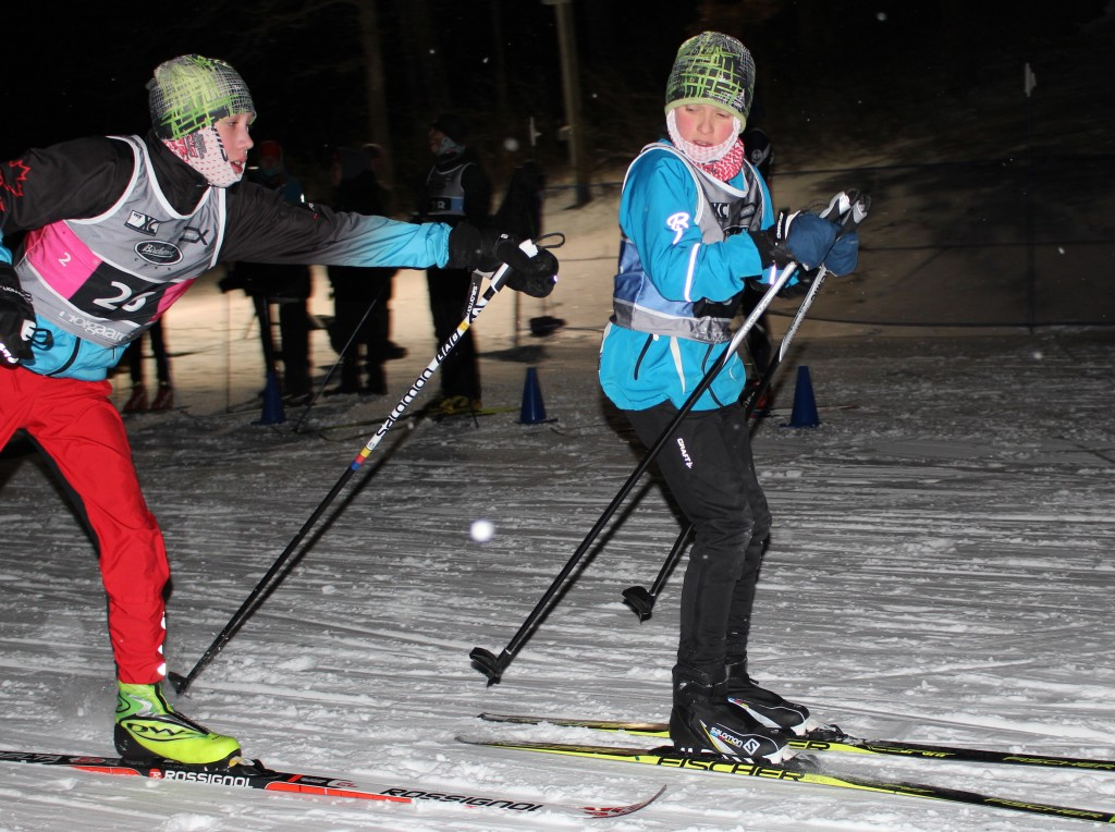 A skier tags his teammate during the youth classic team sprints event Jan. 31 at Theodore Wirth Park. Photo by Nate Gotlieb