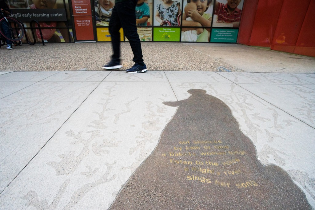 A bronze shadow sculpture installed on Nicollet Mall in 2017.