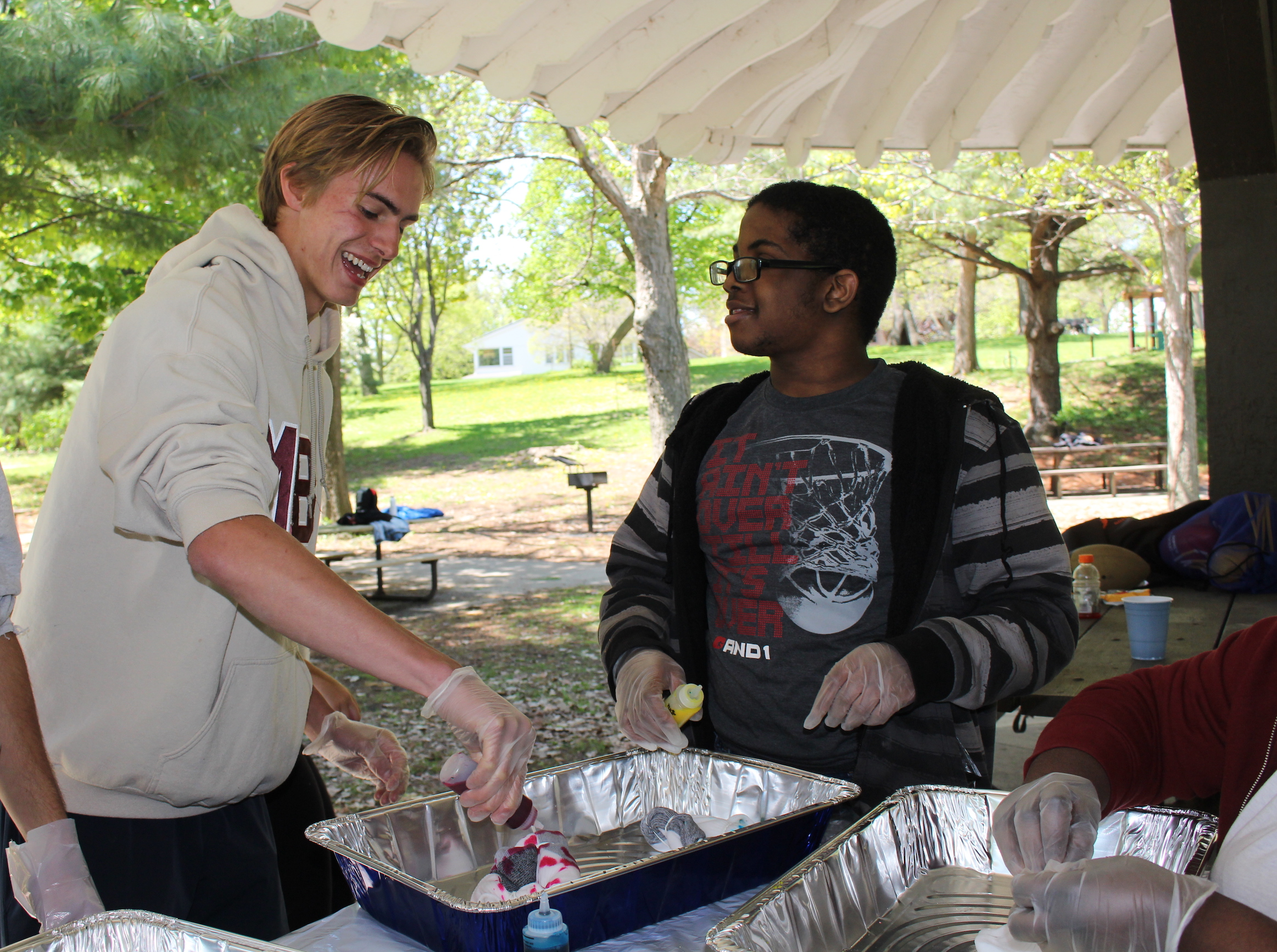 Luke Youngdahl (left) and D'Avian Cyrus tie-dye during the celebration.