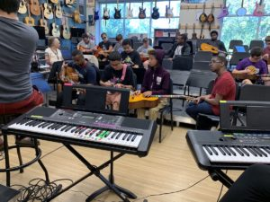 Students in Southwest High School's 3 Strings Guitars