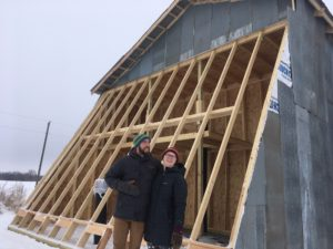 Andrew and Margo Hanson-Pierre with their Deep Winter Greenhouse. Submitted photo